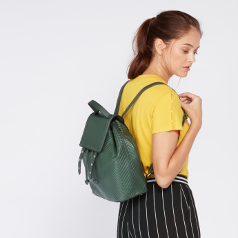 Paprika Quilted Backpack with Eyelet Detail and Magnetic Snap Closure