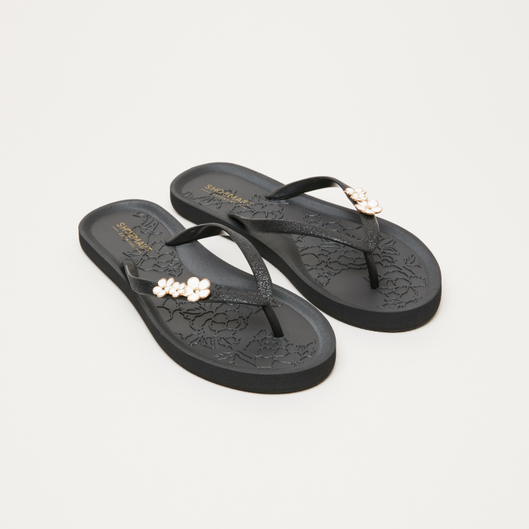 Textured Flip Flops with Floral Detail